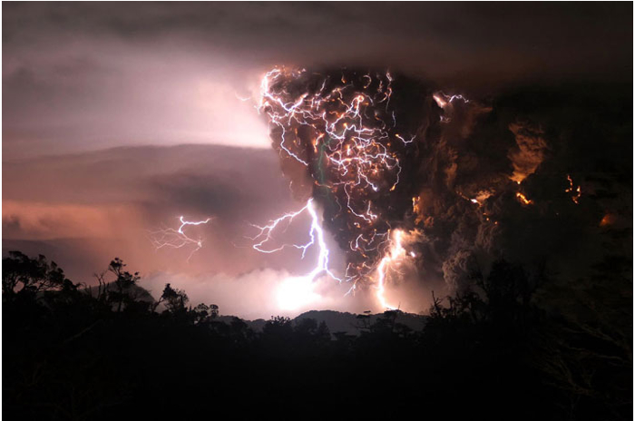 Chile - The fury of Chaitén volcano seems to set the sky on fire. Highly charged particles of pumice roar upward in spreading clouds of gas and smoke, generating crackling tangles of lightning. (Carlos Gutierrez, UP/Digital Railroad)  Source: National Geographic