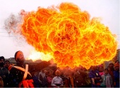 India - In Jammu, a flower of flame blooms from a man's kerosene-filled mouth