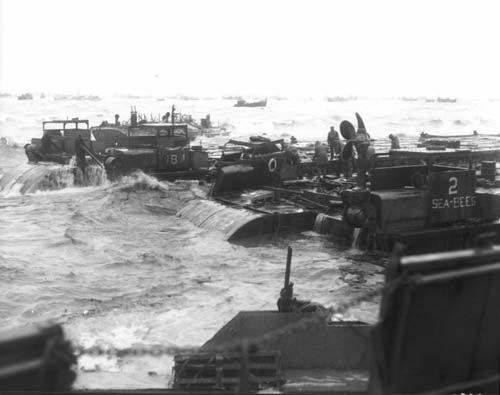 Barges carrying supplies for Soldiers are challenged by pounding surf along the Normandy coast, D-Day, June 6, 1944.Source: www.army.mil