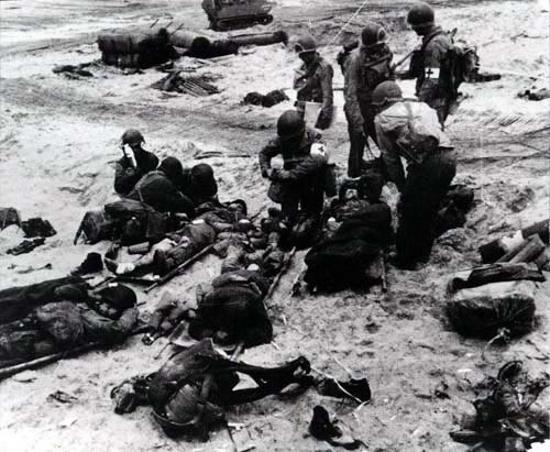 Medics attend to wounded soldiers on Utah Beach in France during the Allied Invasion of Europe on D-Day, June 6, 1944.Source: www.army.mil
