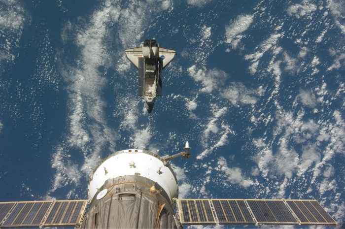 Backdropped by a blue and white Earth, this image shows Endeavour shortly after the shuttle and station began their post-undocking separation.  Credit: http://spaceflight.nasa.gov/gallery/images/shuttle/sts-127/html/iss020e026049.html
