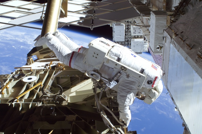Astronaut Mike Foreman, STS-129 mission specialist, participates in the mission's first session of extravehicular activity (EVA) as construction and maintenance continue on the International Space Station. During the six-hour, 37-minute spacewalk, Foreman and astronaut Robert L. Satcher Jr. (out of frame), mission specialist, installed a spare S-band antenna structural assembly to the Z1 segment of the station's truss, or backbone. Foreman and Satcher also installed a set of cables for a future space-to-ground antenna on the Destiny laboratory and replaced a handrail on the Unity node with a new bracket used to route an ammonia cable that will be needed for the Tranquility node when it is delivered next year. The two spacewalkers also repositioned a cable connector on Unity, checked S0 truss cable connections, and lubricated latching snares on the Kibo robotic arm and the station's mobile base system. Date: 19 November 2009  Credit: NASA
