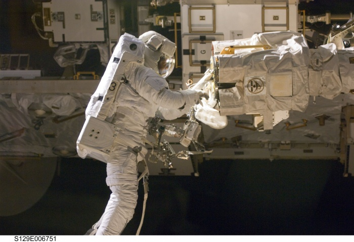 Astronaut Robert L. Satcher Jr., STS-129 mission specialist, participates in the mission's first session of extravehicular activity (EVA) as construction and maintenance continue on the International Space Station. During the six-hour, 37-minute spacewalk, Satcher and astronaut Mike Foreman (out of frame), mission specialist, installed a spare S-band antenna structural assembly to the Z1 segment of the station's truss, or backbone. Foreman and Satcher also installed a set of cables for a future space-to-ground antenna on the Destiny laboratory and replaced a handrail on the Unity node with a new bracket used to route an ammonia cable that will be needed for the Tranquility node when it is delivered next year. The two spacewalkers also repositioned a cable connector on Unity, checked S0 truss cable connections, and lubricated latching snares on the Kibo robotic arm and the station's mobile base system.  Date: 19 November 2009  Source: NASA