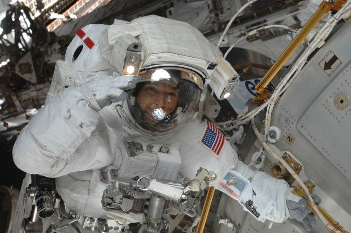 Astronaut Randy Bresnik, STS-129 mission specialist, salutes crewmates while positioned near the European Space Agency's Columbus module on International Space Station. Astronauts Bresnik and Mike Foreman were in the midst of the second of three scheduled spacewalks for this shuttle crew, working in cooperation with the five current crewmembers for the orbital outpost and with their five Atlantis crewmates, all of whom pitched in EVA support from inside. Date: 21 November 2009  Source: http://spaceflight.nasa.gov/gallery/images/shuttle/sts-129/html/s129e007213.html