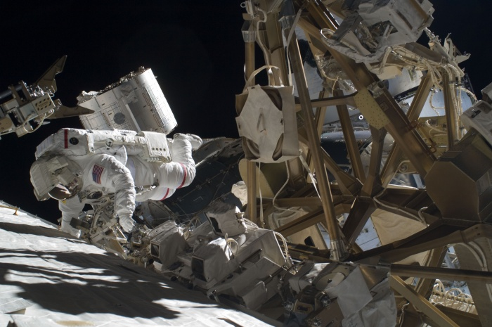 Astronaut Mike Foreman, STS-129 mission specialist, performs a task on the exterior of the International Space Station during the second space walk of Atlantis' visit to the orbital outpost. Date: 21 November 2009  Source: http://spaceflight.nasa.gov/gallery/images/shuttle/sts-129/html/iss021e030674.html