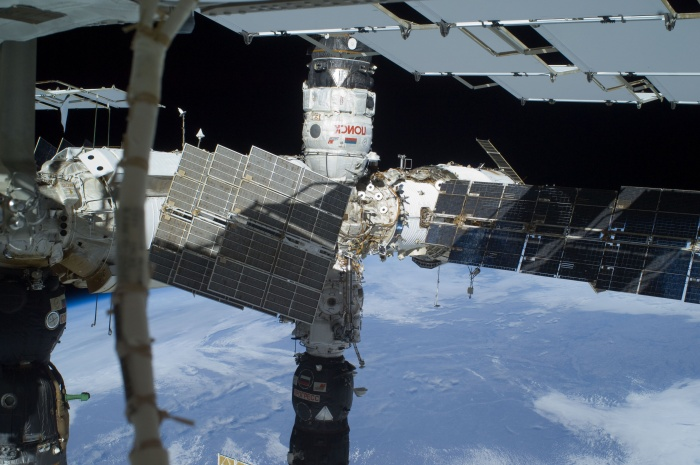 The Russian segment of the International Space Station is featured in this image photographed by a space-walking astronaut during the third and final spacewalk for the STS-129 mission. The Poisk Mini Research Module 2 (MRM2), docked to the space-facing port of the Zvezda Service Module, is at top center; and a Progress resupply vehicle is docked to the Pirs Docking Compartment at bottom center. Zarya (partially obscured by solar panels) is at right center. Earth's horizon and the blackness of space provide the backdrop for the scene. Date: 23 November 2009(2009-11-23)  Source: http://spaceflight.nasa.gov/gallery/images/shuttle/sts-129/html/iss021e031841.html