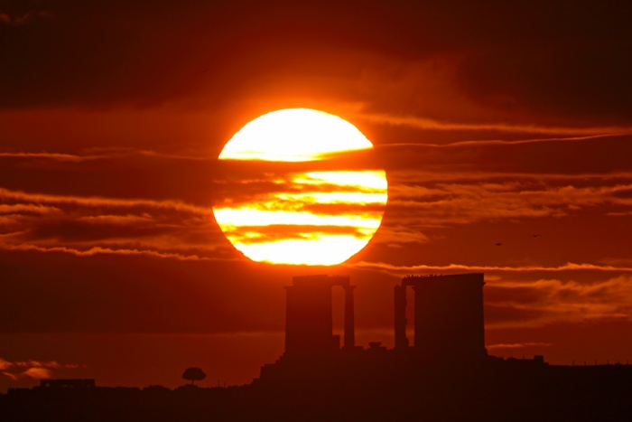 December Sunrise, Cape Sounion Astronomy Picture of the Day - 2009 December 23 Credit & Copyright: Anthony Ayiomamitis (TWAN)  Explanation: The Sun is a moving target. Its annual motion through planet Earth's sky tracks north and south, from solstice to solstice, as the seasons change. On December 21st, the solstice marking the first day of winter in the northern hemisphere and summer in the south, the Sun rose at its southernmost point along the eastern horizon. Earlier this month, looking toward the Aegean Sea from a well-chosen vantage point at Cape Sounion, Greece, it also rose in this dramatic scene. In the foreground lies the twenty-four hundred year old Temple of Poseidon.
