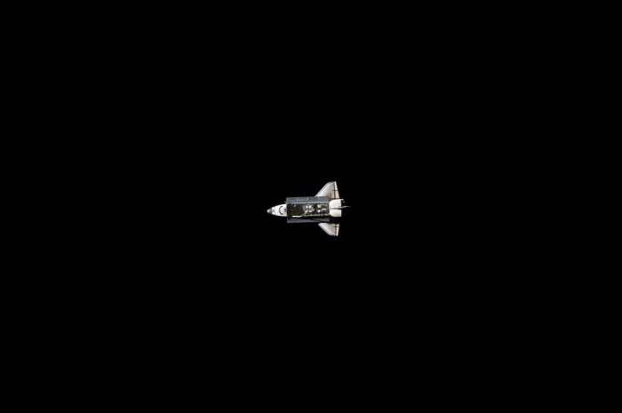 Space Shuttle Atlantis (STS-129), against the blackness of space, approaches closer To the International Space Station, November 18, 2009 As seen from the International Space Station (Expedition 21)  Credit: NASA
