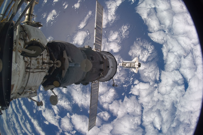 With Earth below, Space Shuttle Atlantis (STS-129) approaches the International Space Station. November 18, 2009. As seen from the International Space Station (Expedition 21)  Credit: NASA