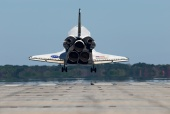 Space Shuttle Atlantis (STS-129) seconds away from a mid-morning landing