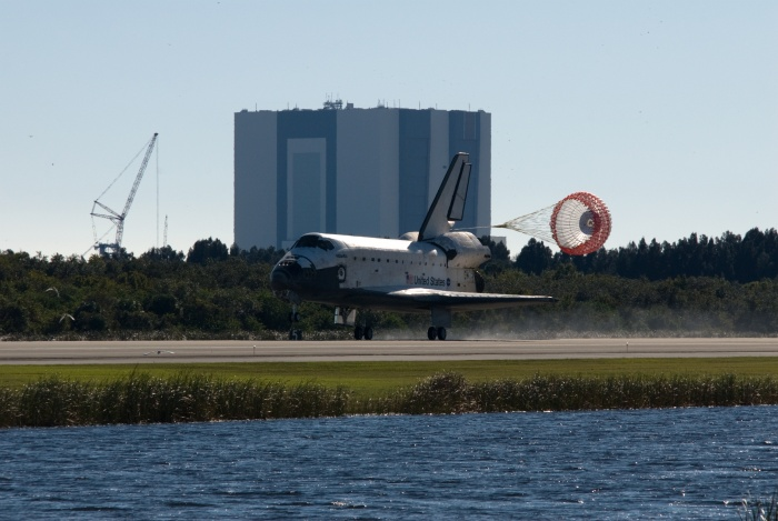 With the main landing gear down and drag parachute deployed and unfurled, Space Shuttle Atlantis (STS-129), landing on Runway 33, November 27, 2009 NASA John F. Kennedy Space Center, State of Florida, USA  Credit: NASA