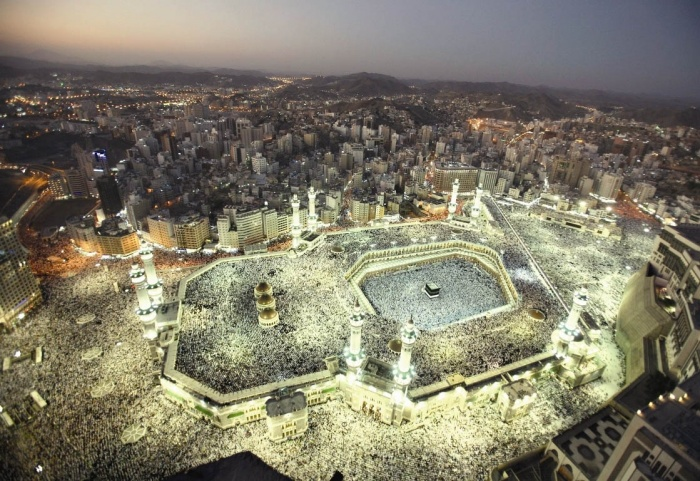 Hundreds of thousands of Muslims circle the Kaaba inside the Grand Mosque during night prayers in the Muslim month of Ramadan in Mecca