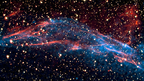 Top Ten Space Pictures of 2009: Shock Wave Spits Out High-Speed Particles  In June scientists with the Chandra X-ray Observatory released this picture of a shock wave plowing through the supernova remnant RCW 86, seen above in both x-ray and visible light. Although the shock wave is moving rapidly, its energy is not heating the surrounding gas as much as it should, scientists say. The new image shows that the extra energy is instead powering up particles and firing them out into space at nearly the speed of light. —Optical image courtesy ESO/E. Helder; x-ray image courtesy NASA/CXC/Univ. of Utrecht/J.Vink et al.   Source: National Geographic