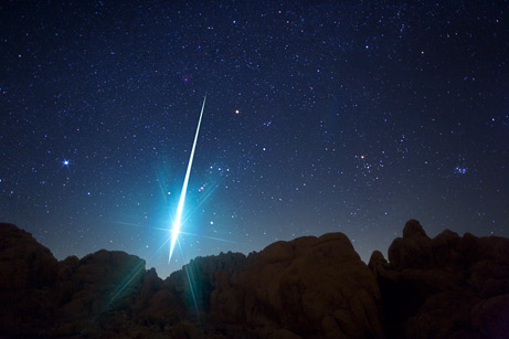 Top Ten Space Pictures of 2009: Geminid Meteor Pierces the Night  Like a silver spear cast from the heavens, the bright streak of a Geminid meteor pierces the night sky over California's Mojave Desert during the annual meteor shower's December 2009 peak.  Geminids are slower than other shooting stars and are known to make beautiful long arcs across the sky. This could be because they're born of debris from a dormant comet and so are made mostly of hard, sun-baked rock that takes longer to burn up in Earth's atmosphere, experts suggest.  —Photograph by Wally Pacholka, TWAN   Source: National Geographic