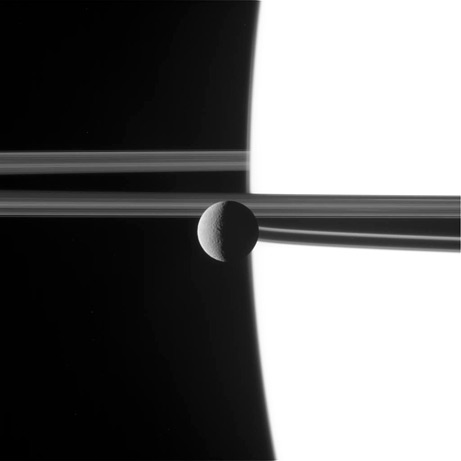 Top Ten Space Pictures of 2009: Saturn Moon Seen in the Raw  The tiny moon Rhea hangs like a pearl in front of Saturn's rings, as seen in a