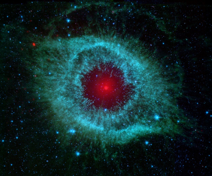 Dust and the Helix Nebula Credit: NASA, JPL-Caltech, Kate Su (Steward Obs, U. Arizona) et al. Astronomy Picture of the Day - 2009 December 31   Explanation: Dust makes this cosmic eye look red. The eerie Spitzer Space Telescope image shows infrared radiation from the well-studied Helix Nebula (NGC 7293) a mere 700 light-years away in the constellation Aquarius. The two light-year diameter shroud of dust and gas around a central white dwarf has long been considered an excellent example of a planetary nebula, representing the final stages in the evolution of a sun-like star. But the Spitzer data show the nebula's central star itself is immersed in a surprisingly bright infrared glow. Models suggest the glow is produced by a dust debris disk. Even though the nebular material was ejected from the star many thousands of years ago, the close-in dust could be generated by collisions in a reservoir of objects analogous to our own solar system's Kuiper Belt or cometary Oort cloud. Formed in the distant planetary system, the comet-like bodies would have otherwise survived even the dramatic late stages of the star's evolution.