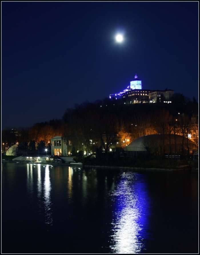 Not a Blue Moon Credit & Copyright: Stefano De Rosa Astronomy Picture of the Day - 2010 January 1  Explanation: This bright Full Moon was captured on December 2nd, shining above a church overlooking the River Po, in Turin, Italy. It was the first Full Moon in December. Shining on celebrations of New Year's Eve, last night's Full Moon was the second Full Moon of December and so fits the modern definition of a Blue Moon - the second Full Moon in a month. Because the lunar cycle, Full Moon to Full Moon, spans 29.5 days, Blue Moons tend to occur in some month about every 2.5 years. Shining in the glare just above and right of December's first Full Moon is the Pleiades star cluster.