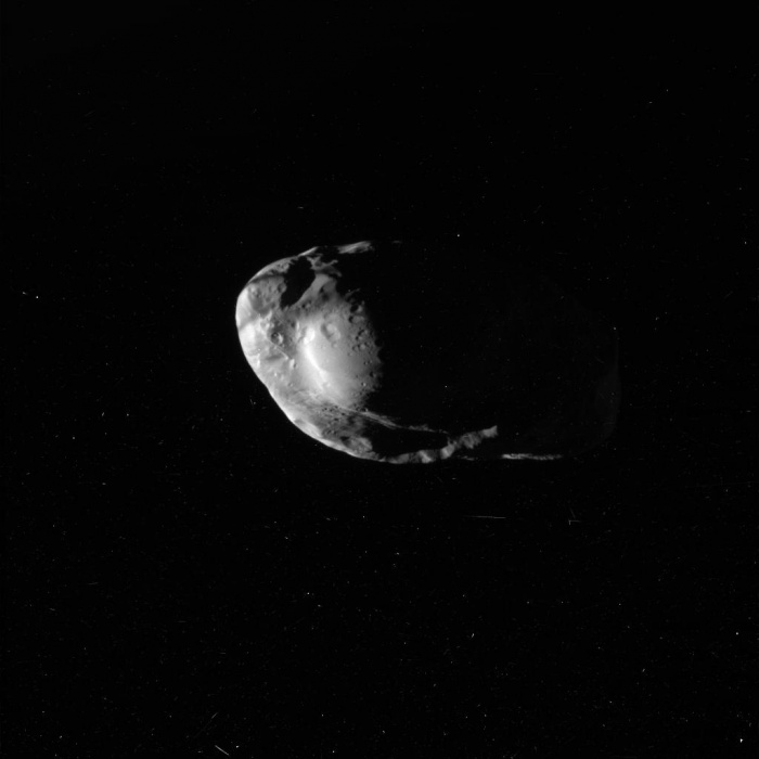 Shepherd Moon Prometheus from Cassini Credit: Cassini Imaging Team, SSI, JPL, ESA, NASA Astronomy Picture of the Day - 2010 February 1  Explanation: Another moon of Saturn has been imaged in detail by the Cassini spacecraft. Orbiting Saturn since 2004, the robotic Cassini got its closest look yet at Saturn's small moon Prometheus last week. Visible above in an unprocessed image from 36,000 kilometers away, Prometheus' 100-km long surface was revealed to have an interesting system of bulges, ridges, and craters. These features, together with the moon's oblong shape and high reflectivity, are now being studied to help better understand the history of Prometheus and Saturn's rings. Prometheus is one of the few shepherd satellites known, as its gravity, along with its companion moon Pandora, confines many smaller ice chucks into Saturn's F Ring. Cassini's next major targeted flyby is of the moon Rhea on March 2.