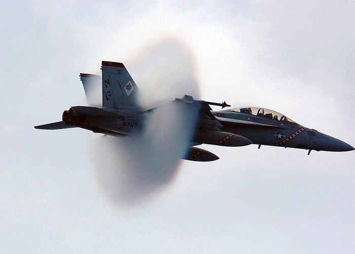 Somewhere over the Philippine Sea a US Navy (USN) F/A-18F Super Hornet, Strike Fighter Squadron 102 (VFA-102), Diamondbacks, Naval Air Station (NAS) Atsugi, Japan (JPN), breaks the sound barrier during a fly-by over the aircraft carrier USS KITTY HAWK (CV 63) [not shown].  Source: Wikipedia