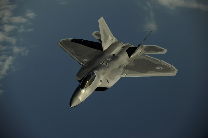 An F-22 Raptor flies over Kadena Air Base, Japan, Jan. 23, 2009 on a routine training mission. The F-22 is deployed from the 27th Fighter Squadron at Langley Air Force Base, Va.  Source: Wikipedia