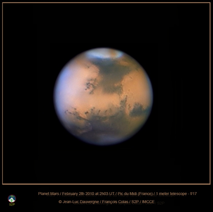 Dust Storm on Mars Credit & Copyright: Jean-Luc Dauvergne, Francois Colas, IMCCE/S2P, Obs. Midi-Pyrénées Astronomy Picture of the Day - 2010 February 5  Explanation: It's spring for the northern hemisphere of Mars and spring on Mars usually means dust storms. So the dramatic brown swath of dust (top) marking the otherwise white north polar cap in this picture of the Red Planet is not really surprising. Taking advantage of the good views of Mars currently possible near opposition and its closest approach to planet Earth in 2010, this sharp image shows the evolving dust storm extending from the large dark region known as Mare Acidalium below the polar cap. It was recorded on February 2nd with the 1 meter telescope at Pic Du Midi, a mountain top observatory in the French Pyrenees.