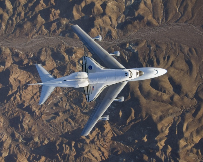 The space shuttle Endeavour, fresh from the STS-126 mission and mounted atop its modified Boeing 747 carrier aircraft, flies over California's Mojave Desert on a three-day trip back to the Kennedy Space Center in Florida on Wednesday Dec. 10, 2008. NASA officials said Wednesday Dec. 17, 2008 that it is looking for ideas on where and how best to display its space shuttles once they stop flying in a few years. Beware: NASA estimates it will cost about $42 million to get each shuttle ready and get it where it needs to go, and the final tab could end up much more. The estimate includes $6 million to ferry the spaceship atop a modified jumbo jet to the closest major airport. (AP Photo/NASA)