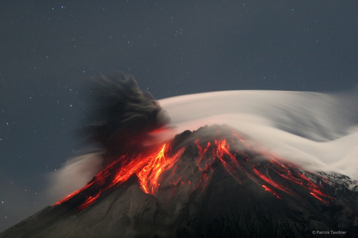 Tungurahua Erupts Credit & Copyright: Patrick Taschler Astronomy Picture of the Day: 2007 September 18  Explanation: Volcano Tungurahua erupted spectacularly last year. Pictured above, molten rock so hot it glows visibly pours down the sides of the 5,000-meter high Tungurahua, while a cloud of dark ash is seen being ejected toward the left. Wispy white clouds flow around the lava-lit peak, while a star-lit sky shines in the distance. The above image was captured last year as ash fell around the adventurous photographer. Located in Ecuador, Tungurahua has become active roughly every 90 years since for the last 1,300 years. Volcano Tungurahua has started erupting again this year and continues erupting at a lower lever even today.