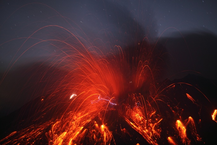 Sakurajima Volcano with Lightning Credit & Copyright: Martin Rietze (Alien Landscapes on Planet Earth) Astronomy Picture of the Day - 2010 February 10  Explanation: Why does a volcanic eruption sometimes create lightning? Pictured above, the Sakurajima volcano in southern Japan was caught erupting early last month. Magma bubbles so hot they glow shoot away as liquid rock bursts through the Earth's surface from below. The above image is particularly notable, however, for the lightning bolts caught near the volcano's summit. Why lightning occurs even in common thunderstorms remains a topic of research, and the cause of volcanic lightning is even less clear. Surely, lightning bolts help quench areas of opposite but separated electric charges. One hypothesis holds that catapulting magma bubbles or volcanic ash are themselves electrically charged, and by their motion create these separated areas. Other volcanic lightning episodes may be facilitated by charge-inducing collisions in volcanic dust. Lightning is usually occurring somewhere on Earth, typically over 40 times each second.