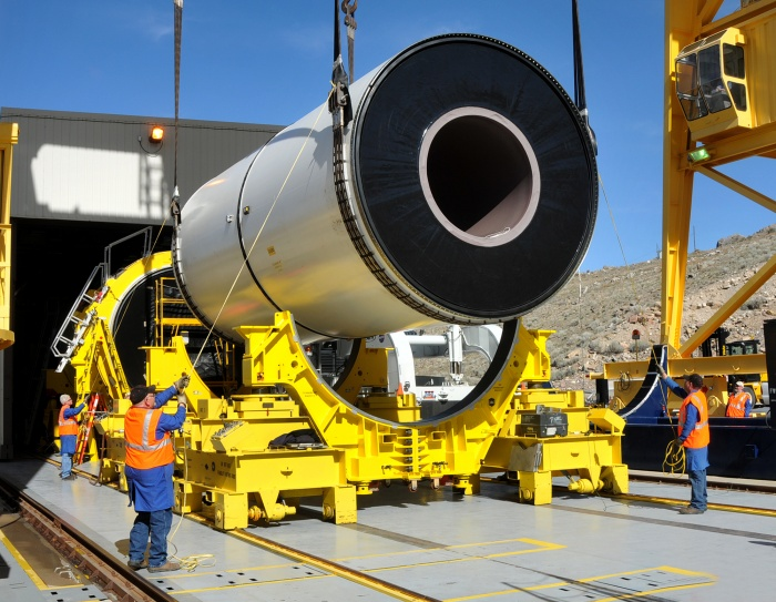 September 2010 - Technicians at ATK Space System's test stand in Promontory, Utah, gently guided a segment of NASA's five-segment development motor, or DM-2, into place in preparation for the second full-duration ground test, also called a