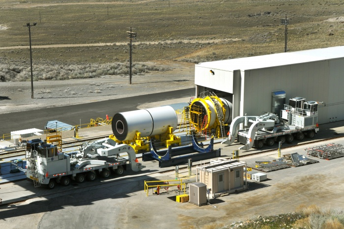 On April 12, NASA began moving segments of the second Ares I rocket's five-segment development motor, or DM-2, from a production facility in Promontory, Utah, to the nearby test stand in preparation for the second full-duration ground test scheduled for September 2010. Engineers from NASA's Marshall Space Flight Center in Huntsville, Ala., manage the team that will conduct this full-scale motor test – designed to advance the knowledge, safety, technology and capability of solids rocket motors. The DM-2 motor includes several upgrades and technology improvements implemented by NASA and ATK engineers. Engineers will use the measurements gathered from the test to evaluate thrust, roll control, acoustics, motor vibrations, nozzle modifications and insulation upgrade. Following ATK's manufacturing procedures, the segments were cast and then went through a complete X-ray inspection. The moving of segments to the test area will continue at a rate of one per week until the final segment arrives May 13. The time between segments allows for insertion into the test stand and assembly as each piece arrives. Manufactured by ATK Space Systems, a division of Alliant Techsystems of Brigham City, Utah, the prime contractor for the Ares first stage, the motor is similar to the reusable solid rocket booster currently used by the space shuttle, although the new motor is one segment longer and has been modified to accommodate current mission objectives. (Credit: NASA/ATK)