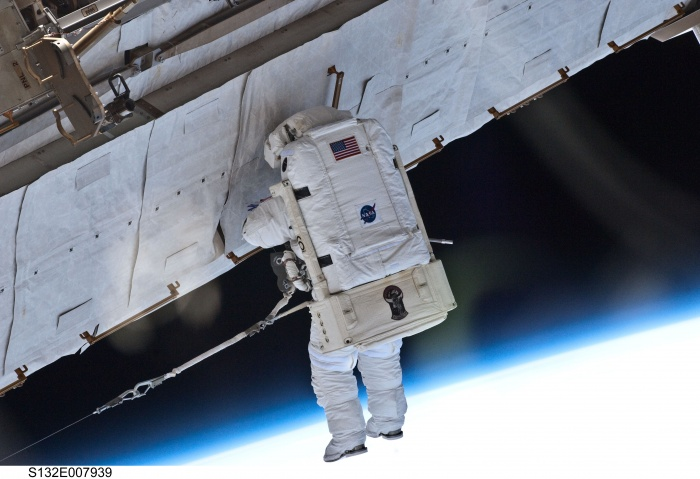 S132-E-007939 (17 May 2010) --- NASA astronaut Garrett Reisman, STS-132 mission specialist, participates in the mission's first session of extravehicular activity (EVA) as construction and maintenance continue on the International Space Station. During the seven-hour, 25-minute spacewalk, Reisman and NASA astronaut Steve Bowen (out of frame), mission specialist, loosened bolts holding six replacement batteries, installed a second antenna for high-speed Ku-band transmissions and adding a spare parts platform to Dextre, a two-armed extension for the station's robotic arm.