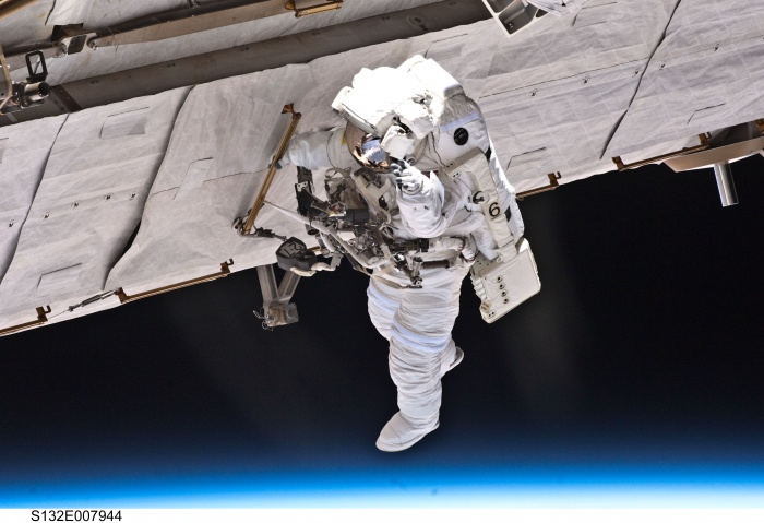 S132-E-007944 (17 May 2010) --- NASA astronaut Garrett Reisman, STS-132 mission specialist, participates in the mission's first session of extravehicular activity (EVA) as construction and maintenance continue on the International Space Station. During the seven-hour, 25-minute spacewalk, Reisman and NASA astronaut Steve Bowen (out of frame), mission specialist, loosened bolts holding six replacement batteries, installed a second antenna for high-speed Ku-band transmissions and adding a spare parts platform to Dextre, a two-armed extension for the station's robotic arm.