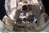 Garrett Reisman, STS-132 mission specialist, takes a busy