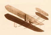 The world's first airplane model, the Wright Flyer, in flight