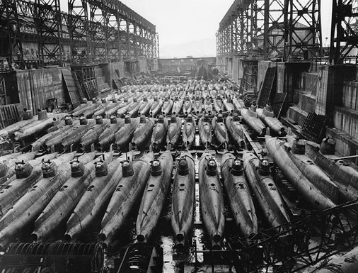 By the end of WWII, the Japanese had produced hundreds of midget subs of various designs and intended to use them as a final weapon of war against the U.S. This photo, taken October 19, 1945, shows 84 midget subs in a drydock at Kure Naval Base.   Source: PBS