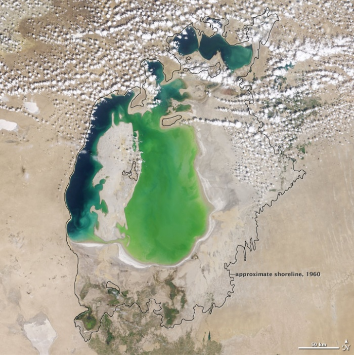 In the 1960s, the Soviet Union undertook a major water diversion project on the arid plains of Kazakhstan, Uzbekistan, and Turkmenistan. The region's two major rivers, fed from snowmelt and precipitation in far-away mountains, were used to transform the desert into fields for cotton and other crops. Before the project, the two rivers left the mountains, cut northwest through the Kyzylkum Desert—the Syrdar'ya to the north and the Amudar'ya in parallel to the south—and finally pooled together in the lowest part of the desert basin. The lake they made, the Aral Sea, was once the fourth largest lake in the world. Photo NASA