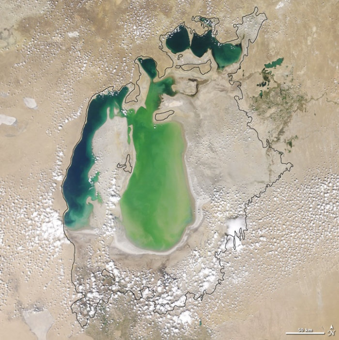 Aral sea in 2001 as seen by images from the Moderate Resolution Imaging Spectroradiometer (MODIS) on NASA's Terra satellite. Although irrigation made the desert bloom, it devastated the Aral Sea. This series of images from the Moderate Resolution Imaging Spectroradiometer (MODIS) on NASA's Terra satellite documents the changes in the the Aral Sea throughout the past decade. At the start of the series in 2000, the lake was already a fraction of its 1960 extent (black line). The Northern Aral Sea (sometimes called the Small Aral Sea) had separated from the Southern (Large) Aral Sea. The Southern Aral Sea had split into an eastern and a western lobe that remained tenuously connected at both ends. Photo and words: NASA