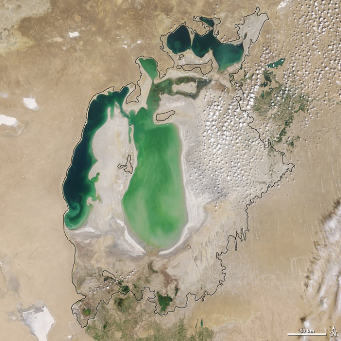 Aral sea in 2002 as seen by images from the Moderate Resolution Imaging Spectroradiometer (MODIS) on NASA's Terra satellite. By 2001, the southern connection had been severed, and the shallower eastern part retreated rapidly over the next several years. As the lake dried up, fisheries and the communities that depended on them collapsed. The increasingly salty water became polluted with fertilizer and pesticides. The blowing dust from the exposed lakebed, contaminated with agricultural chemicals, became a public health hazard. The salty dust blew off the lakebed and settled onto fields, degrading the soil. Croplands had to be flushed with larger and larger volumes of river water. The loss of the moderating influence of such a large body of water made winters colder and summers hotter and drier. Photo and words: NASA