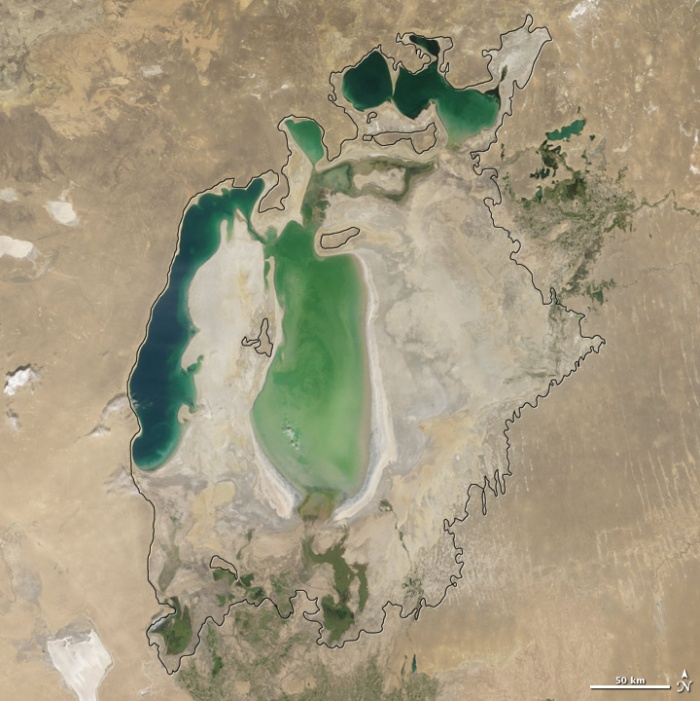 Aral sea in 2004 as seen by images from the Moderate Resolution Imaging Spectroradiometer (MODIS) on NASA's Terra satellite. By 2001, the southern connection had been severed, and the shallower eastern part retreated rapidly over the next several years. As the lake dried up, fisheries and the communities that depended on them collapsed. The increasingly salty water became polluted with fertilizer and pesticides. The blowing dust from the exposed lakebed, contaminated with agricultural chemicals, became a public health hazard. The salty dust blew off the lakebed and settled onto fields, degrading the soil. Croplands had to be flushed with larger and larger volumes of river water. The loss of the moderating influence of such a large body of water made winters colder and summers hotter and drier. Photo and words: NASA