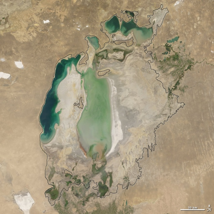 Aral sea in 2005 as seen by images from the Moderate Resolution Imaging Spectroradiometer (MODIS) on NASA's Terra satellite. By 2001, the southern connection had been severed, and the shallower eastern part retreated rapidly over the next several years. As the lake dried up, fisheries and the communities that depended on them collapsed. The increasingly salty water became polluted with fertilizer and pesticides. The blowing dust from the exposed lakebed, contaminated with agricultural chemicals, became a public health hazard. The salty dust blew off the lakebed and settled onto fields, degrading the soil. Croplands had to be flushed with larger and larger volumes of river water. The loss of the moderating influence of such a large body of water made winters colder and summers hotter and drier. Photo and words: NASA