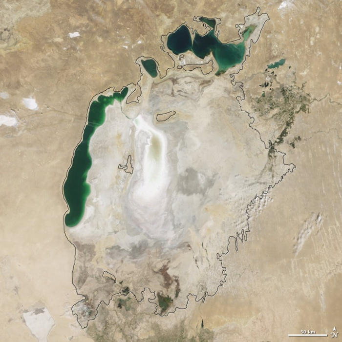 Aral sea in 2009 as seen by images from the Moderate Resolution Imaging Spectroradiometer (MODIS) on NASA's Terra satellite. The final image in the series is from the summer of 2009. Blowing dust (salt-laden sediments) covers a large part of the sea. In a last-ditch effort to save some of the lake, Kazakhstan built a dam between the northern and southern parts of the Aral Sea. Completed in 2005, the dam was basically a death sentence for the southern Aral Sea, which was judged to be beyond saving. All of the water flowing into the desert basin from the Syrdar'ya now stays in the Northern Aral Sea. Between 2005 and 2006, the water levels in that part of the lake rebounded significantly and very small increases are visible throughout the rest of the time period. The differences in water color are due to changes in sediment. Photo and words: NASA