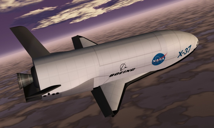 An artist's conception of the X-37 Advanced Technology Demonstrator as it glides to a landing on earth. Its design features a rounded fuselage topped by an experiment bay; short, double delta wings (like those of the Shuttle orbiter); and two stabilizers (that form a V-shape) at the rear of the vehicle.