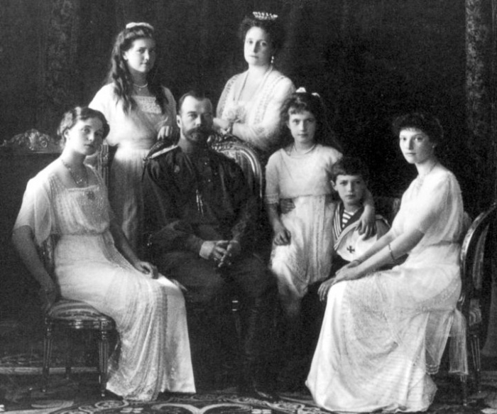 Here are the Romanovs in happier times (1913), with Maria standing behind her father to the left of her mother, and Alexei between Anastasia (left) and Tatiana (right)  Source: http://www.thehistoryblog.com/archives/345