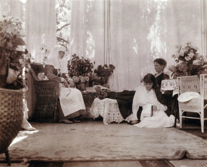 Grand Duchess Anastasia sits with her mother, Alexandra, and sister Olga in her mother's sitting room ca. 1916. This photo of Grand Duchess Olga and Anastasia Nikolaevna of Russia and Tsarina Alexandra is from the Beinecke Library. It can be used if credit is given to the library. The correct credit line is Romanov Collection, General Collection, Beinecke Rare Book and Manuscript Library, Yale University. The address is http://beinecke.library.yale.edu/dl_crosscollex/SearchExecXC.asp