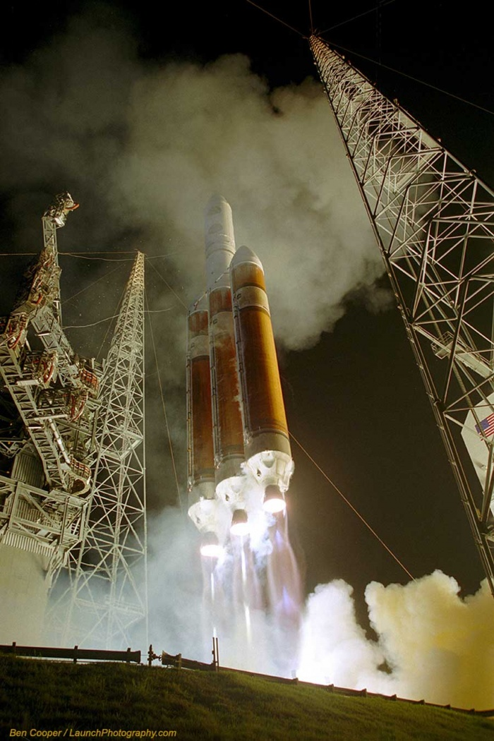Launch of a Delta IV Heavy  Credit:Ben Cooper(Launch Photography)  Astronomy Picture of the Day -2010 December 14  Explanation: It is the tallest rocket in active use. The Delta IV Heavy is the largest of the Delta series, packing the punch of three rocket boosters instead of the usual one. The resulting rocket, the most powerful in use by the US Air Force, is capable of lifting over 23,000 kilograms into low Earth orbit, comparable to NASA's Space Shuttle. Pictured above is the second launch of the Delta IV Heavy from Cape Canaveral, Florida, USA in 2007, and the first night launch. Complex service towers are visible to each side of the soaring rocket. The rocket successfully lifted a reconnaissance satellite to low Earth orbit. The Delta IV Heavy has since completed several more successful lift-offs, while its next launch is currently planned from Vandenberg Air Force Base, California, USA, next month.