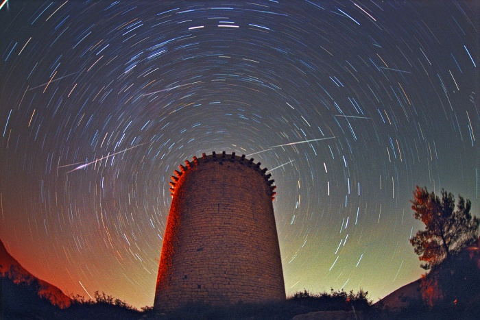 Leonids Above Torre de la Guaita  Credit:Juan Carlos Casado(TWAN) Astronomy Picture of the Day -2010 December 12  Explanation: In 1999, Leonids Meteor Shower came to an impressive crescendo. Observers in Europe saw a sharp peak in the number of meteors visible around 0210 UTC during the early morning hours of November 18. Meteor counts then exceeded 1000 per hour - the minimum needed to define a true meteor storm. At other times and from other locations around the world, observers typically reported respectable rates of between 30 and 100 meteors per hour. This photograph is a 20-minute exposure ending just before the main Leonids peak began. Visible are at least five Leonid meteors streaking high above the Torre de la Guaita, an observation tower used during the 12th century in Girona, Spain. Over the next few nights, the Geminids are expected to put on the best meteor show of this year.