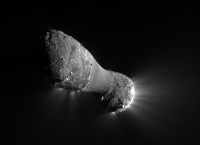 Multiverses: 700 Kilometers Below Comet Hartley 2  Credit: NASA, JPL-Caltech, UMD, EPOXI Mission   Astronomy Picture of the Day - 2010 November 8  Explanation: What kind of comet is this? Last week, NASA's robotic EPOXI spacecraft whizzed past Comet 103P/Hartley, also known as Comet Hartley 2, and recorded images and data that are both strange and fascinating. EPOXI was near its closest approach -- about 700 kilometers away -- when it snapped the above picture. As expected, the comet has indeed shown itself to be a tumbling iceberg orbiting the Sun between Earth and Jupiter. However, unexpected features on the images have raised many questions. For example, where are all the craters? Why is there a large smooth area around the middle? How much of Comet Hartley 2 is a loose pile of dust and ice shards? Future analyses and comparisons to other comet nuclei may answer some of these questions and, hopefully, lead to a better general understanding of comets, meteors, and the early Solar System.