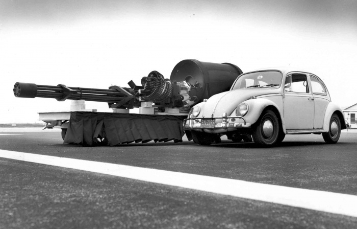 The GAU-8/A Avenger Gatling gun next to a VW Type 1. Removing an installed GAU-8 from an A-10 requires first installing a jack under the aircraft's tail as the cannon makes up most of the aircraft's forward weight.