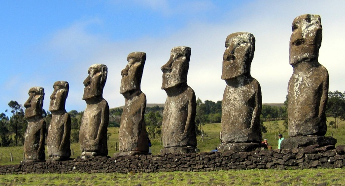 Its stone giants on average stand 13 feet high and weigh 14 tons, large heads on male torsos fashioned after the penis, carved from volcanic ash, called moai. They stand on sacred pedestals called ahu. Do not walk on these platforms. Most all of the moai are erected around the coast and face inland towards their villages with their backs to the sea.  Source: http://www.highonadventure.com/Hoa06dec/Steve/Easter.htm
