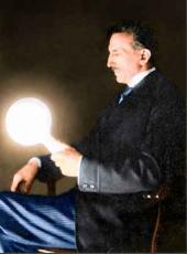 Tesla holding a gas-filled phosphor-coated light bulb